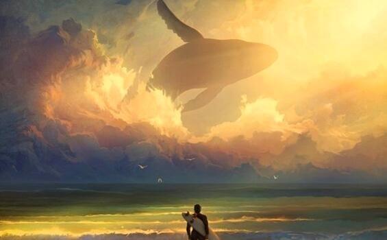 surffaaja sekä valas taivaalla