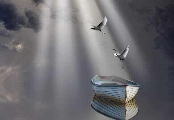 yksinäinen vene ja linnut