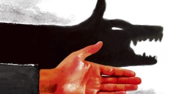 käsi tekee suden varjon