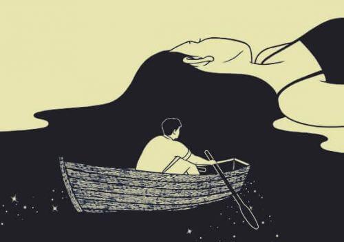 mies soutaa veneellä naisen hiuksissa