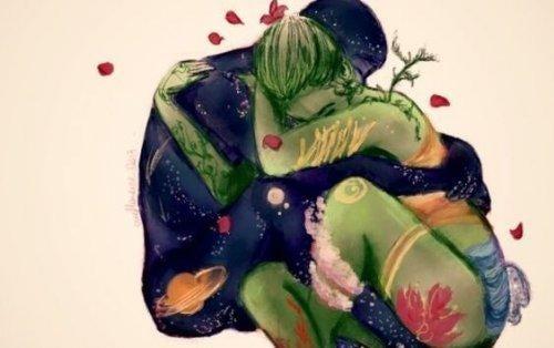 vihreä nainen ja sininen mies halaavat