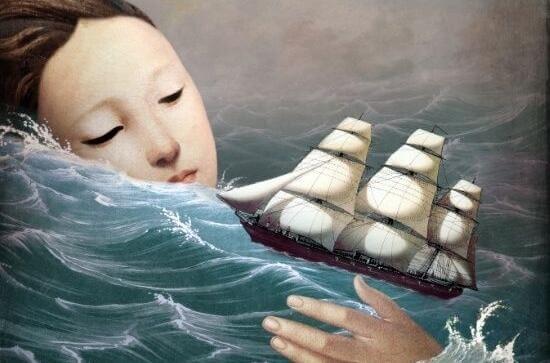 nainen vedessä purjeveneen kanssa