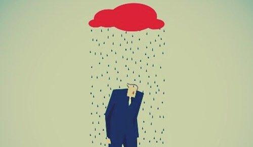 miehen päällä on sadepilvi
