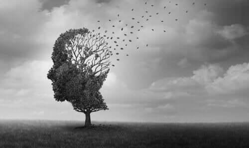 puun muotoinen pää josta lähtee lehtiä